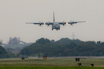 A C-130J Super Hercules approaches the runway at Yokota