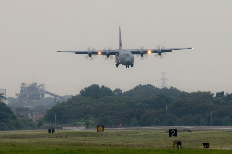 A C-130J Super Hercules approaches the runway at Yokota