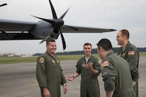 Crewmembers with the 36th Airlift Squadron talks after landing at Yokota