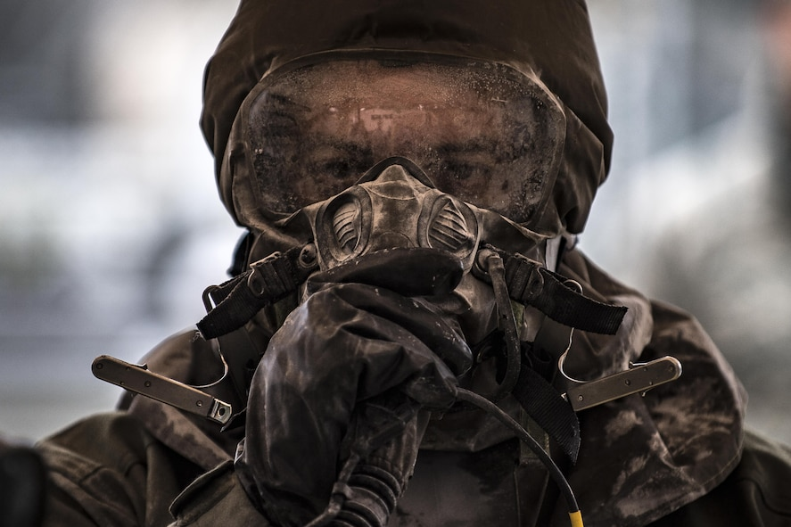 U.S. Air Force Senior Master Sgt. Bryan McCoy, Aberdeen Proving Ground Air Force Life Cycle Management Center Aircrew Flight Equipment superintendent, walks through a decontamination line during the Aircrew Contamination Mitigation course on Ramstein Air Base, Germany, Sept. 19, 2017.