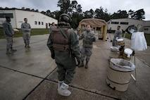 U.S. Air Force Airman 1st Class Adriya Osinski, 86th Operations Support Squadron Aircrew Flight Equipment technician, prepares Airman 1st Class Yang Ren, 86th OSS AFE technician, for decontamination during the Aircrew Contamination Mitigation course on Ramstein Air Base, Germany, Sept. 19, 2017.