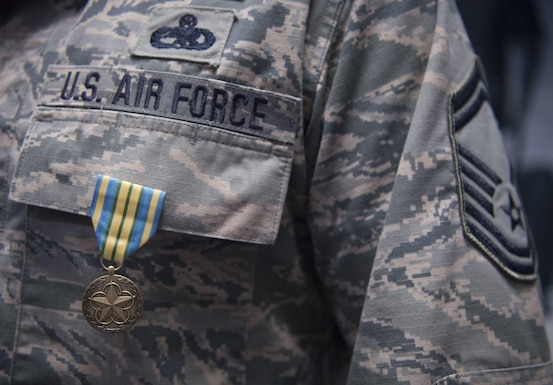 U.S. Air Force Senior Master Sgt. Kevan Williams, a safety technician with the 130th Airlift Wing, stands with his newly pinned Military Outstanding Volunteer Service Medal Sept. 16, 2017.