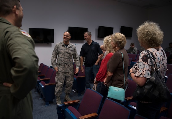 U.S. Air Force Senior Master Sgt. Kevan Williams, a safety technician with the 130th Airlift Wing, is congratulated by friends, family, and coworkers after a small ceremony where he was awarded the Military Outstanding Volunteer Service Medal Sept. 16, 2017.