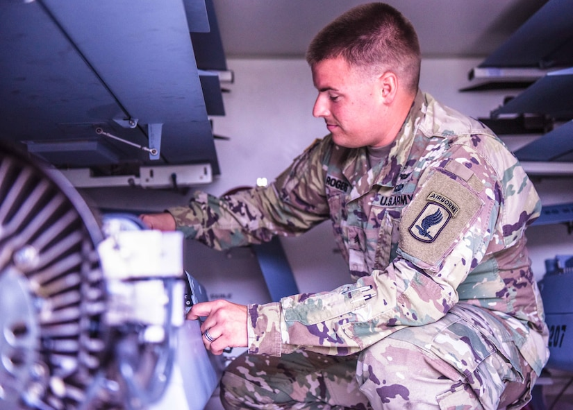 Army Sgt. Kyle Martin Rogers, an unmanned aircraft systems repairer from Delta Company, 54th Brigade Engineering Battalion, 173rd Airborne Brigade, Vicenza, Italy, inspects his unit's equipment, Sept. 8 2017. Army photo by Sgt. David Vermilyea