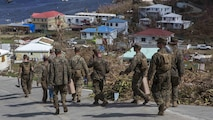 U.S. Marines Battalion Landing Team 2nd Battalion, 6th Marine Regiment, 26th Marine Expeditionary Unit (MEU), walk back to a landing zone after clearing roadways in a community affected by Hurricane Irma in St. John, U.S. Virgin Islands, Sept. 17, 2017. The 26th MEU is supporting authorities in the U.S. Virgin Islands with the combined goal of protecting the lives and safety of those in affected areas.