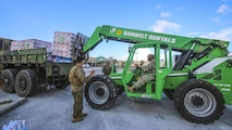 Marines and Soldiers work together to unload cases of water to a distribution point in Key West, Fl., Sept. 14, 2017. Marines and Sailors with the 26th Marine Expeditionary Unit helped distribute food, water, and supplies in support of the Federal Emergency Management Agency in the aftermath of Hurricane Irma.