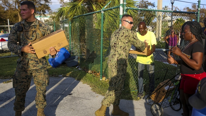 Marines and Sailors hand out food and water to the public in Key West Fl., Sept. 12, 2017. Marines and Sailors with the 26th Marine Expeditionary Unit (MEU) and Marine Heavy Helicopter Squadron (HMH) 461 helped distribute food, water, and supplies in support of the Federal Emergency Management Agency in the aftermath of Hurricane Irma.