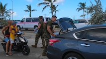 Marines pass out water to citizens at a distribution point in Key West, Fl., Sept. 14, 2017. Marines and Sailors with the 26th Marine Expeditionary Unit helped distribute food, water, and supplies in support of the Federal Emergency Management Agency in the aftermath of Hurricane Irma.