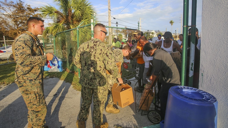 Marines and Sailors hand out water to the public in Key West Fl., Sept. 12, 2017. Marines and Sailors with the 26th Marine Expeditionary Unit (MEU) and Marine Heavy Helicopter Squadron (HMH) 461 helped distribute water and supplies in support of the Federal Emergency Management Agency in the aftermath of Hurricane Irma.
