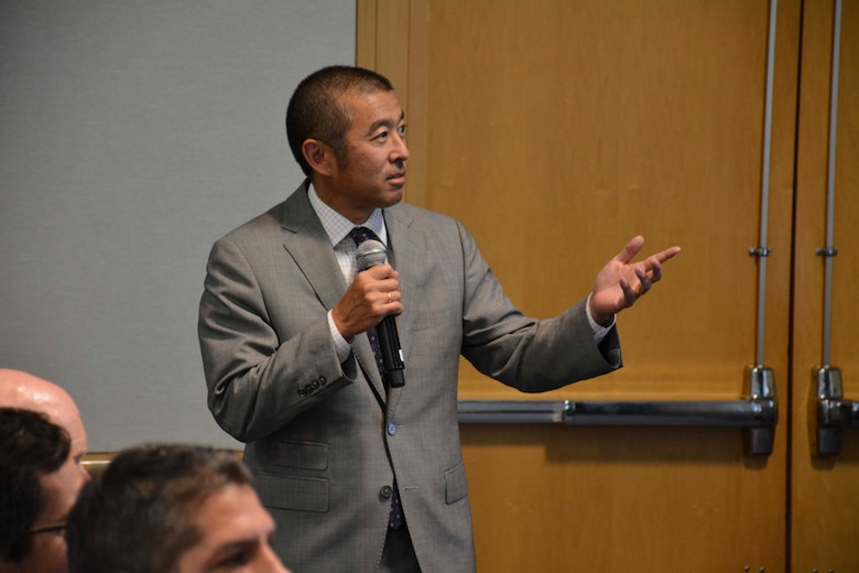 Edwin Oshiba, deputy director of civil engineers and deputy chief of staff for logistics, engineering, and force protection, briefs attendees of Air Force Day at Energy Exchange on Aug. 17, 2017.