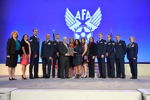 Air Force Association's Chairman of the Board F. Whitten Peters, Secretary of the Air Force Heather Wilson, Air Force Chief of Staff Gen. David Goldfein and Chief Master Sgt. of the Air Force Kaleth Wright present awards during the Air, Space, Cyber Conference