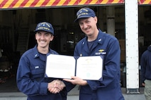 CAPT Tlapa congratulates LTJG Lash upon receiving the Coast Guard Achievement Medal.