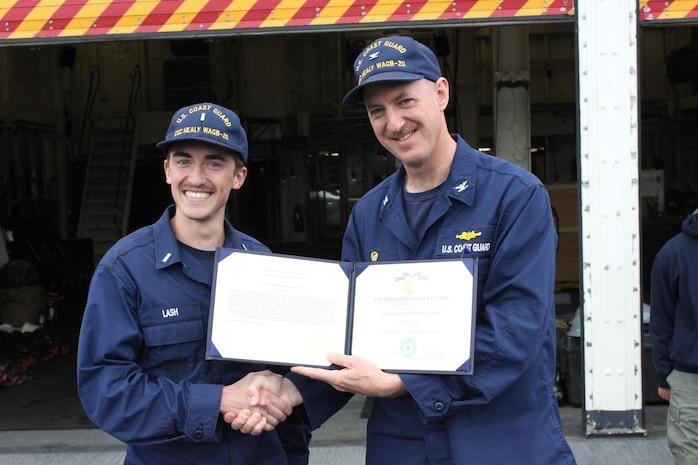 CAPT Tlapa congratulates LTJG Lash upon receiving the Coast Guard Achievement Medal.