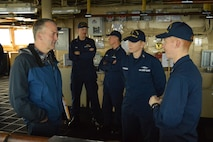LTJG Brian Hagerty and BMCM Andrea Martynowski show Senator Dan Sullivan the navigation equipment HEALY uses while underway in the Arctic.
