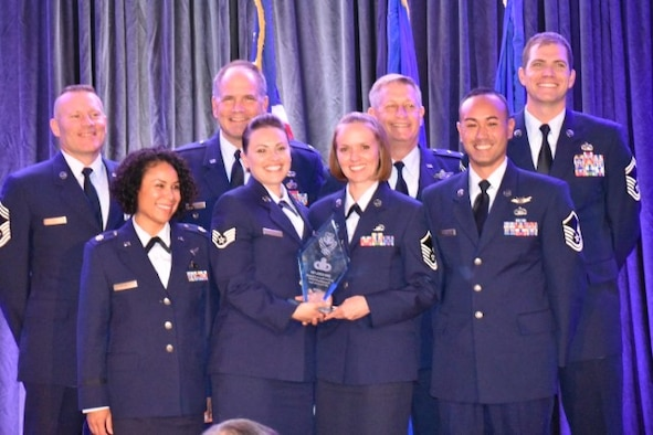 Reserve Citizen Airmen from the 310th Space Wing were awarded the 2016 Outstanding Air Reserve Component Operations Group Intelligence/Operations Support Squadron Unit of the Year in recognition of the excellent contributions of the wing's intelligence personnel at a banquet in San Antonio, TX, Aug. 16, 2017.