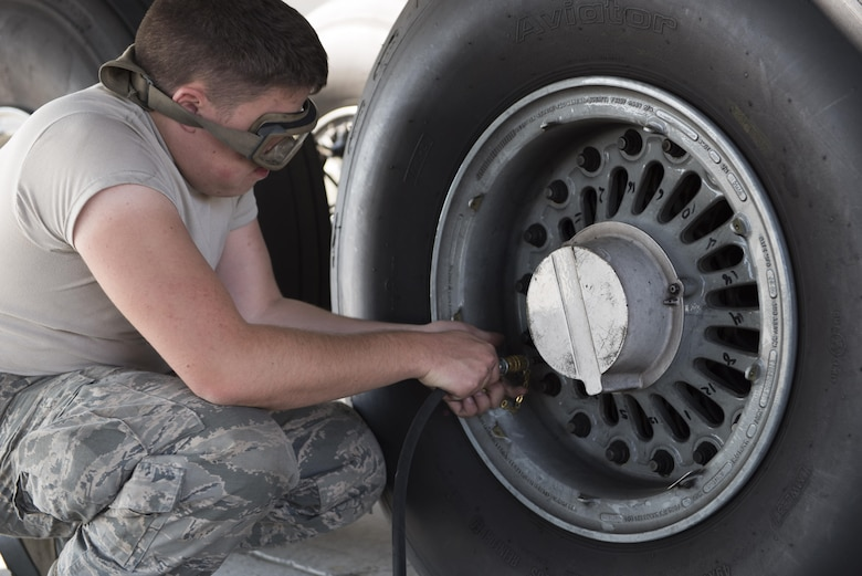 Airman 1st Class Dominick Castro, 92nd Aircraft Maintenance Squadron crew chief, refills a tire on a KC-135 Stratotanker with nitrogen at Fairchild Air Force Base, Washington, Sept. 11, 2017. The KC-135 is an aerial refueling platform capable of delivering more than 200,000 pounds of fuel to U.S. and allied nation aircraft globally at a moment's notice. (U.S. Air Force photo by Airman 1st Class Ryan Lackey)