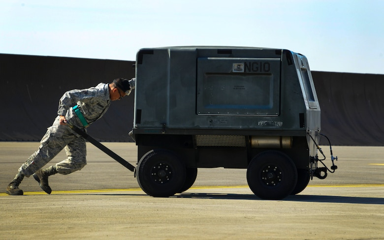Airman 1st Class Nikolaus Hernandezsire, 92nd Aircraft Maintenance Squadron crew chief, pushes a nitrogen servicing cart during an exercise Sept. 11, 2017, at Fairchild Air Force Base, Washington. The nitrogen servicing cart is used to service certain aircraft, is fully automatic and operates in all types of weather. It is a self-contained, enclosed, skid mount, electric driven designed to produce gaseous Nitrogen to support multiple airframes. (U.S. Air Force photo/Senior Airman Janelle Patiño)