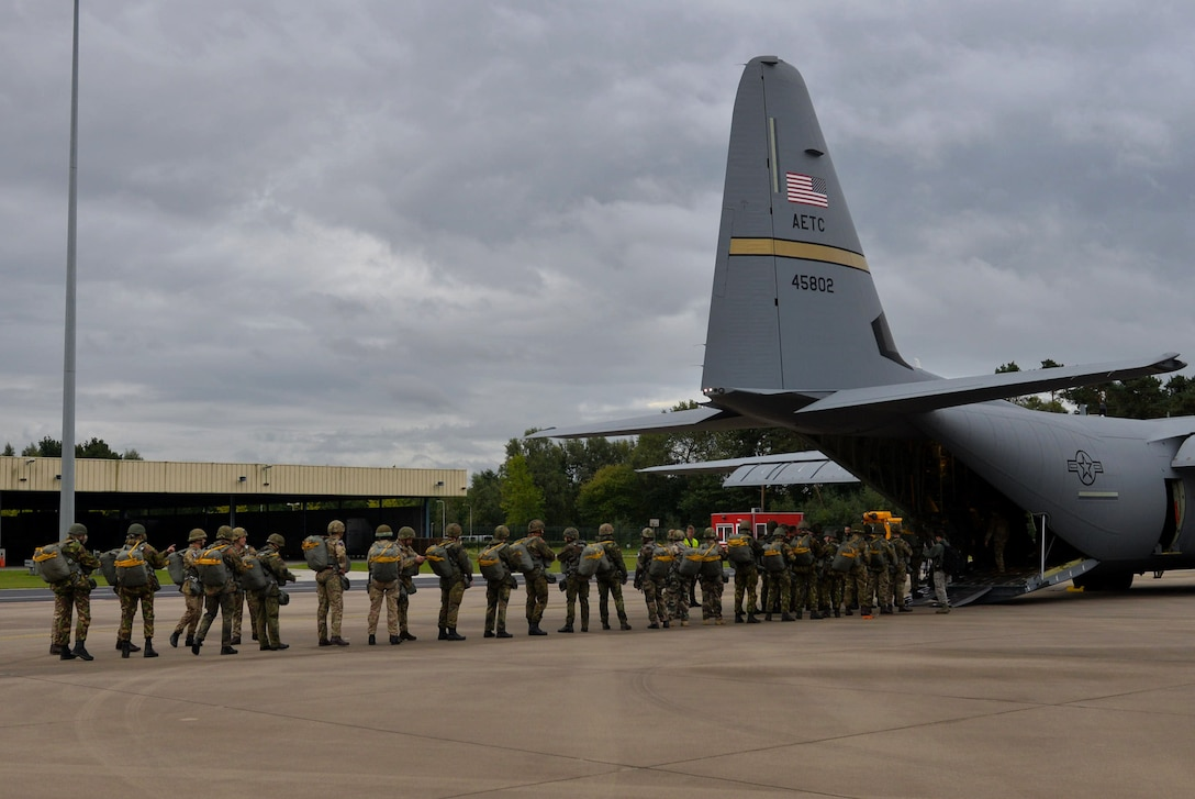 Paratroopers from multiple countries load a C-130J assigned to Little Rock Air Force Base, Ark., Sept. 14, 2017, at Eindhoven Air Base, Netherlands. Aircrew from the 62nd Airlift Squadron conducted a personnel drop over Ginkelse Heide, the drop zone used during Operation Market Garden in 1944. (U.S. Air Force photo by Airman 1st Class Codie Collins)