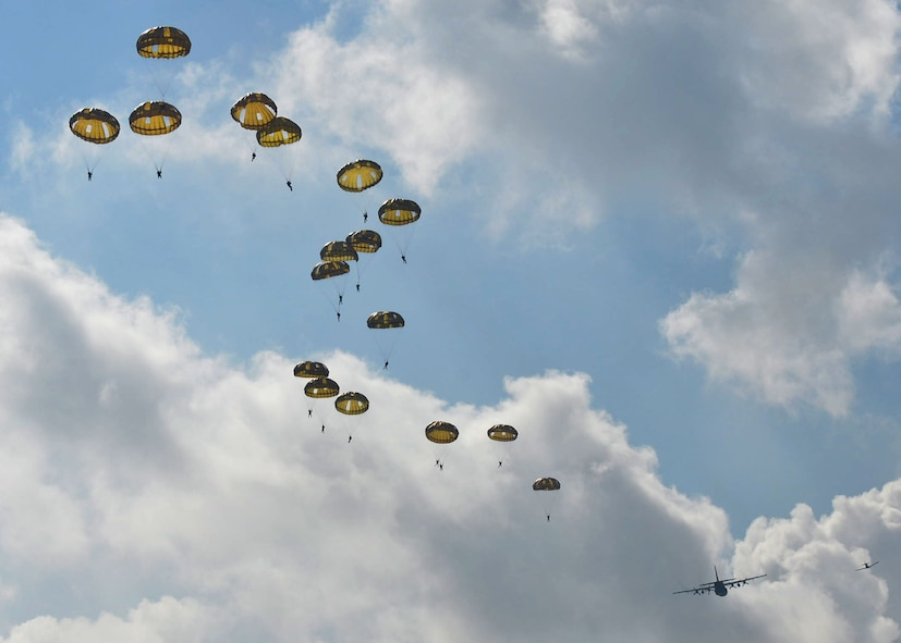 Paratroopers from multiple countries jump from a C-130J assigned to Little Rock Air Force Base, Ark., Sept. 14, 2017, at Eindhoven Air Base, Netherlands. Aircrew from the 62nd Airlift Squadron conducted a personnel drop over Ginkelse Heide, the drop zone used during Operation Market Garden in 1944. (U.S. Air Force photo by Airman 1st Class Codie Collins)