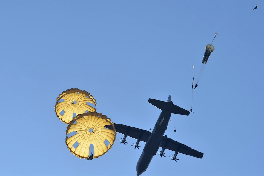 A C-130J from Little Rock Air Force Base, Ark., is flown over the Houtdorperveld Drop Zone as paratroopers conduct a static line jump Sept. 15, 2017, during exercise Falcon Leap. Aircrew members from the 62nd Airlift Squadron worked alongside eight different nations to honor and remember the sacrifices made in 1944 during Operation Market Garden. (U.S. Air Force photo by Airman 1st Class Codie Collins)