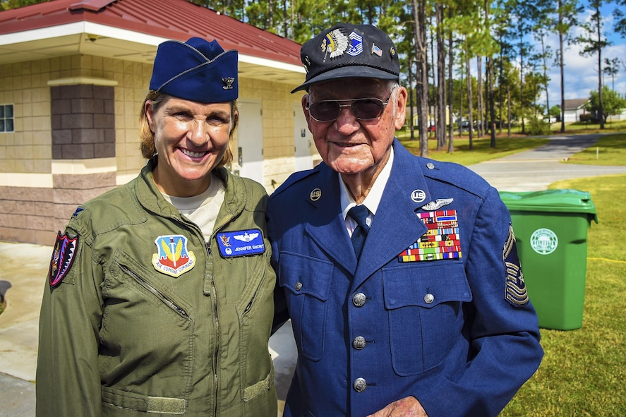U.S. Air Force Col. Jennifer Short, 23d Wing commander, left, and retired Chief Master Sgt. Jim E. Harring pose for a photo during an U.S. Air Force 70th birthday celebration, Sept. 16, 2017, in Valdosta, Ga. Harring was a charter member of the Air Force, who first enlisted in the Army Air Corps on Jan. 8, 1947 and served in the military for over 30 years. (U.S. Air Force photo by Airman Eugene Oliver)