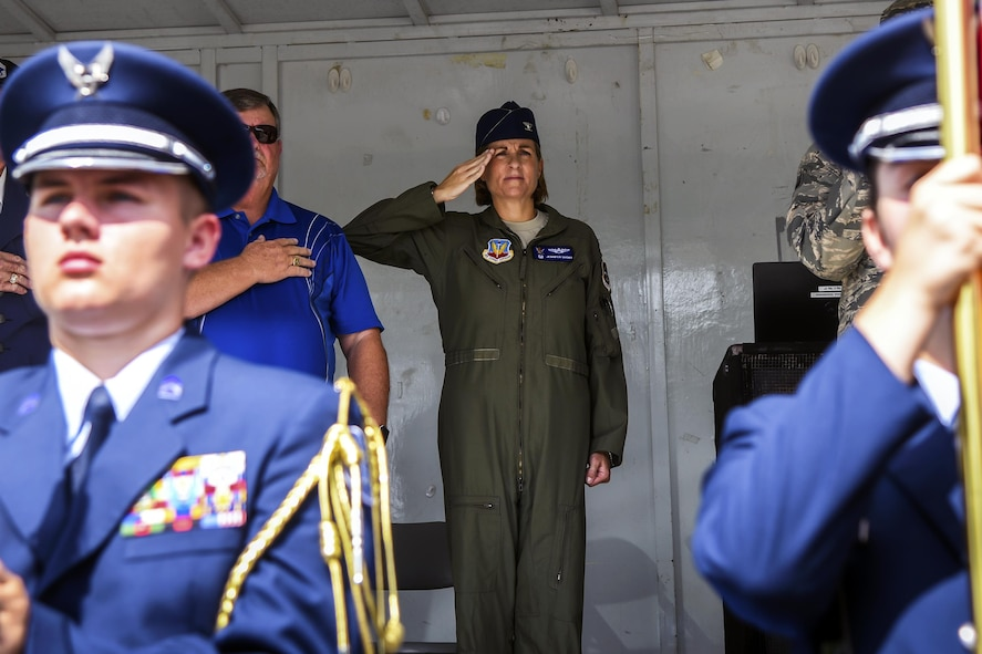 Col. Jennifer Short, 23d Wing commander, renders a salute during the national anthem at a U.S. Air Force 70th birthday celebration, Sept. 16, 2017, in Valdosta Ga. The local community and military members joined together to celebrate their 70-year-long partnership. (U.S. Air Force photo by Airman Eugene Oliver)