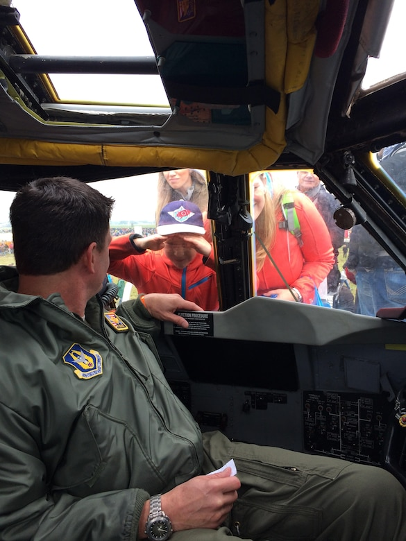 Lt. Col. John P. Booker, the 343rd Bomb Squadron Commander, interacts with visitors from the pilot seat of a B-52 Stratofortress during the NATO Days 2017 Air Show in Ostrava, Czech Republic, Sept. 17, 2017.