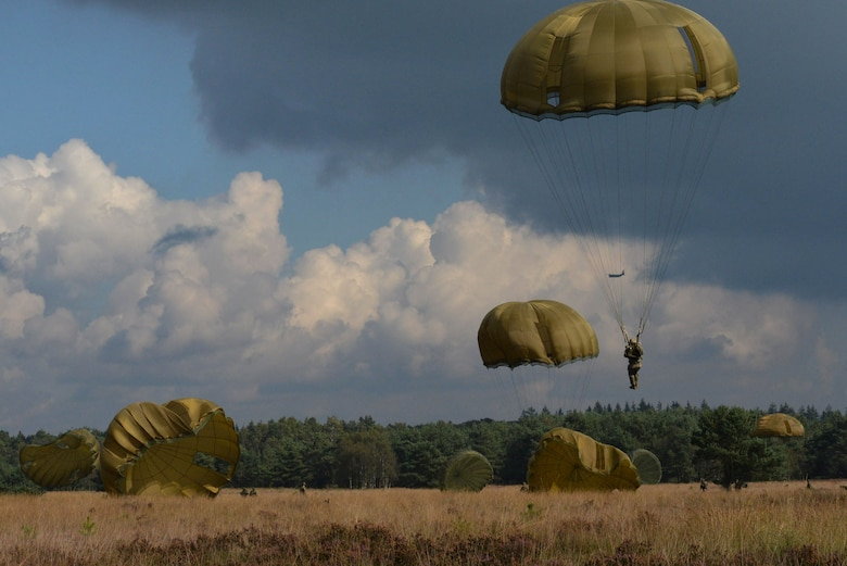 Parachute canopies fill the sky as paratroopers from eight countries land at the Houtdorperveld Drop Zone during Falcon Leap Sept. 15, 2017, Ermelo, Netherlands. (U.S. Air Force photo by Airman 1st Class Codie Collins)