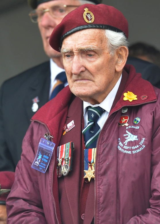 A World War II and Operation Market Garden veteran stands for a moment of silence to remember those who sacrificed their lives 73 years ago on Sept. 16, 2017, at Ede, Netherlands. This event marks the 73rd anniversary of Operation Marked Garden, the largest airborne operation in history. (U.S. Air Force photo by Airman 1st Class Codie Collins)