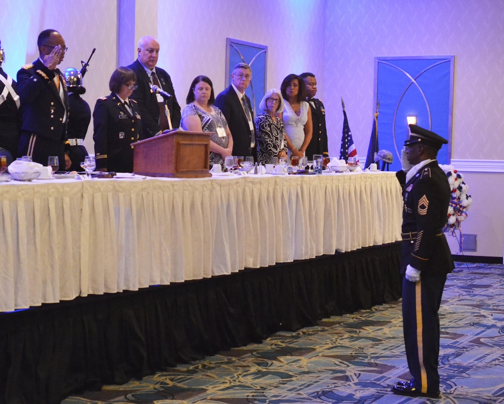 Soldiers, Veterans, retirees and civilians from the 80th TC and the 80th Division Veterans Association gathered to celebrate the centennial anniversary of the military unit. Master Sgt. Lewis Parker, the senior (Color) sergeant, salutes Maj. Gen. A.C. Roper, former commander of the 80th Training Command, to signify the start of the celebration. (U.S. Army photo by Sgt. 1st Class Emily D. Anderson, 80th Training Command)
