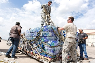 Airmen prepare pallets of water and supplies for transport from Joint Base San Antonio-Lackland, Texas, Sept. 21, 2017, to St. Croix and Puerto Rico for Hurricane Maria relief efforts. Photos by Air Force Ismael Ortega