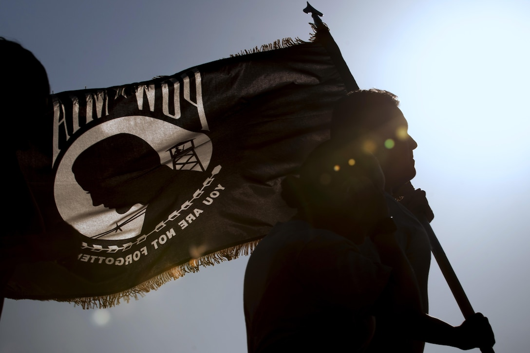 An Airman runs with a POW/MIA flag during a POW/MIA Recognition Day event at Kunsan Air Base, South Korea, Sept. 14, 2017. Kunsan AB Airmen and Soldiers participated in a 24-hour run in recognition of POW/MIA service members. (U.S. Air Force photo by Staff Sgt. Victoria H. Taylor)
