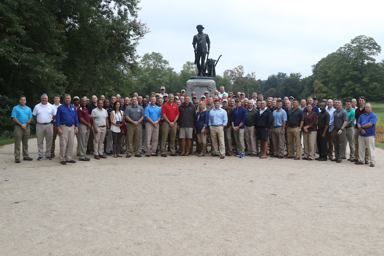 Soldiers and Airmen of the Mississippi National Guard gather around the Concord Minuteman statue for a group photo, September 16, 2017, in Concord, Massachusetts.