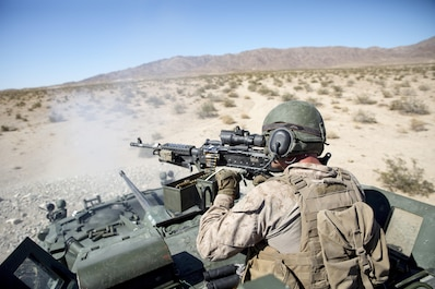 A U.S. Marine with 3rd Light Armored Reconnaissance Battalion, Regimental Combat Team-8, fires an M240B medium machine gun from a light armored vehicle during Large Scale Exercise-17 at Twentynine Palms, Calif., Aug. 18, 2017. LSE-17 is a multinational exercise, led by 2nd Marine Division, with elements from the United Kingdom, France, Canada and II Marine Expeditionary Force, focused on integrating all capabilities of the Marine Air-Ground Task Force and coalition forces. (U.S. Marine Corps photo by Lance Cpl. Holly Pernell)