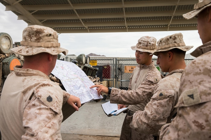 U.S. Marines with Apache Company, 3rd Light Armored Reconnaissance Battalion, Marine Air-Ground Task Force-8 (MAGTF), review the scheme of maneuver prior to departure in support of the final exercise during Integrated Training Exercise 5-17 (ITX), on Marine Corps Air Ground Combat Center Twentynine Palms, Calif., Aug. 3, 2017. The purpose of ITX is to create a challenging, realistic training environment that produces combat-ready forces capable of operating as an integrated MAGTF. (U.S. Marine Corps photo by Cpl. Christopher A. Mendoza)