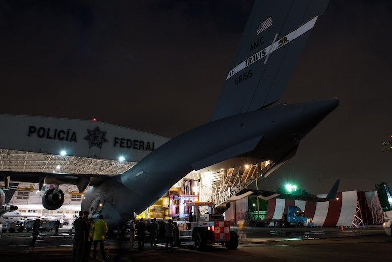 Equipment and medical supplies belonging to a U.S. Agency for International Development elite disaster team are offloaded from a Travis Air Force Base, Calif., Globemaster III at the Mexico City International Airport, Sept. 21, 2017. The team arrived in Mexico to support search and rescue efforts after a 7.1 magnitude earthquake struck the country.  (U.S. Air Force photo by Master Sgt. Joseph Swafford)
