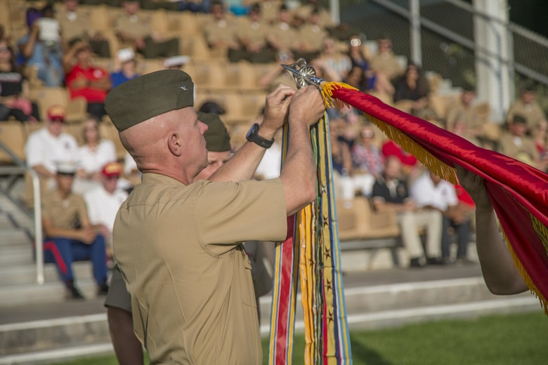Colonel William H. Vivian, regimental commander, 7th Marine Regiment, rededicates the regimental battle colors at Lance Cpl Torrey L. Gray Field, Marine Corps Air Ground Combat Center, Twentynine Palms, Calif., Sept. 15th, 2017. The 7th Marine Regiment celebrated its 100th anniversary with a rededication of battle colors and a parade of troops. (U.S. Marine Corps photo by Lance Cpl Preston Morris)
