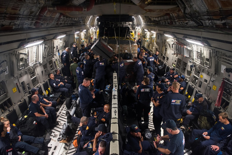 Members of a U.S. Agency for International Development elite disaster prepare to fly on a Travis Air Force Base C-17 Globemaster III at March Air Reserve Base, Calif., Sept. 20, 2017. At the request of the Mexican government, the team was headed for Mexico to support search and rescue efforts after a 7.1 magnitude earthquake struck the country.  (U.S. Air Force photo by Master Sgt. Joseph Swafford)