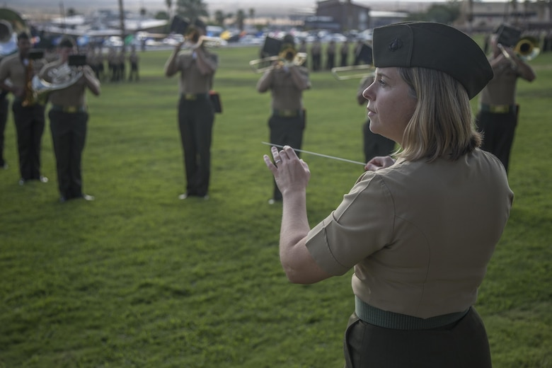 Chief Warrant Officer 3 Stephanie Wire, 1st Marine Division Band, conducts the pre-serenade at the rededication ceremony of 7th Marine Regiment at Lance Cpl Torrey L. Gray Field, Marine Corps Air Ground Combat Center, Twentynine Palms, Calif., Sept. 15th, 2017. The 7th Marine Regiment celebrated its 100th year anniversary with a rededication of the regimental battle colors and a parade of troops. (U.S. Marine Corps photo by Lance Cpl Preston Morris)