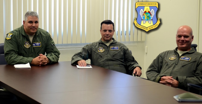 From left to right, Col. Michael LoForti, 920th Operations Group commander, together with Chief Master Sgt. Shane Smith, 920th OG superintendent and Lt. Col. Jeff Hannold, the groups' mission commander, pose during a meeting to demonstrate how they rode out the historic Hurricane Irma Sept. 11, 2017, in Smith's house while sitting around the chief's dinner table, listening to roof shingles fly off the house, the three ensured the AF Reserve's response to state and federal officials was ready to go the moment the storm passed. (U.S. Air Force photo/Maj.Cathleen Snow)