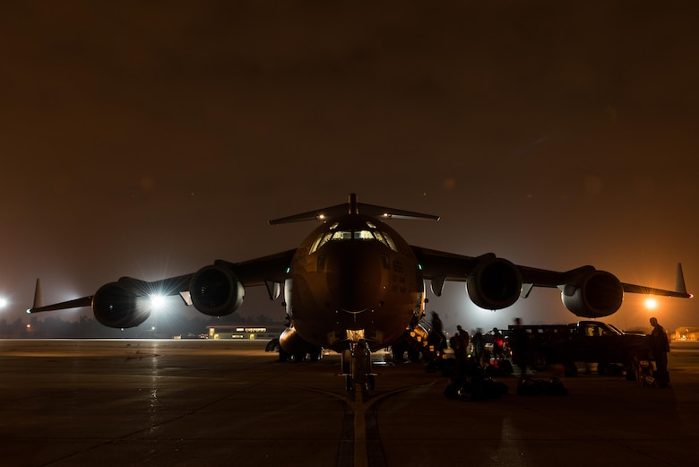 Members of an U.S. Agency for International Development elite disaster board a Travis Air Force Base C-17 Globemaster III at March Air Reserve Base, Calif., Sept. 20, 2017. At the request of the Mexican government, the team was headed for Mexico to support search and rescue efforts after a 7.1 magnitude earthquake struck the country.  (U.S. Air Force photo by Master Sgt. Joseph Swafford)