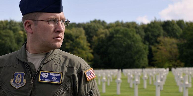 U.S. Air Force Reserve Master Sgt. Scott Klobucher, a loadmaster assigned to the 327th Airlift Squadron, 913th Airlift Group, takes a moment to reflect on history during a wreath laying ceremony at Ardennes American Military Cemetery in Neupre, Belgium, Sept. 12, 2017. The ceremony honored several squadrons from WWII that have roots back to current units at Little Rock AFB. (U.S. Air Force photo by Airman 1st Class Codie Collins)