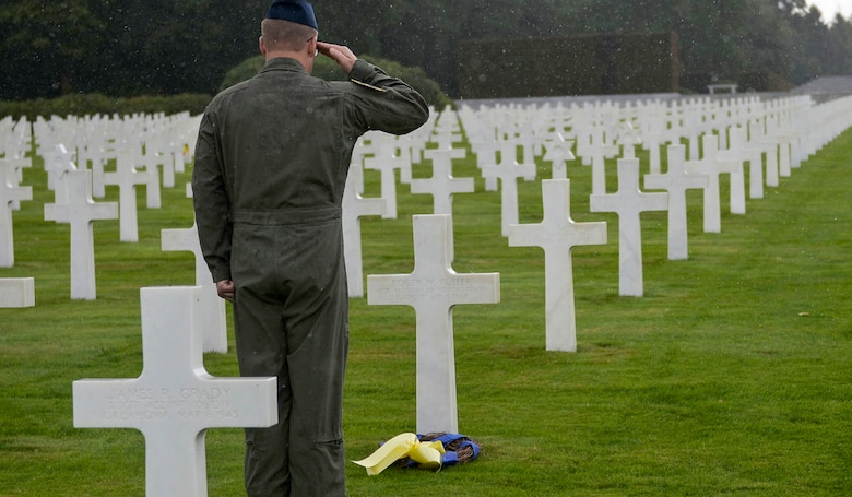 U.S. Air Force Reserve Master Sgt. Scott Klobucher, a loadmaster assigned to the 327th Airlift Squadron, 913th Airlift Group, places the final wreath of the day at Ardennes American Military Cemetery in Neupre, Belgium, Sept. 12, 2017. Klobucher placed the wreath on the grave of Staff Sgt. Roger W. Fuller, 327th Bomb Squadron, 92 Bomb Group, Illinois, who died April 11, 1944. (U.S. Air Force photo by Airman 1st Class Codie Collins)