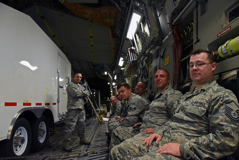 Airmen from the 105th Airlift Wing stand by with a Joint Incident Site Communications Capability system in a C-17 Globemaster III aircraft at Stewart Air National Guard Base, New York.