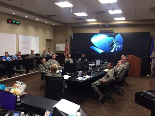 U.S. Air Force Col. April Vogel, commander of the 6th Air Mobility Wing, speaks to the Crisis Action Team at MacDill Air Force Base, Fla., Sept. 8, 2017.