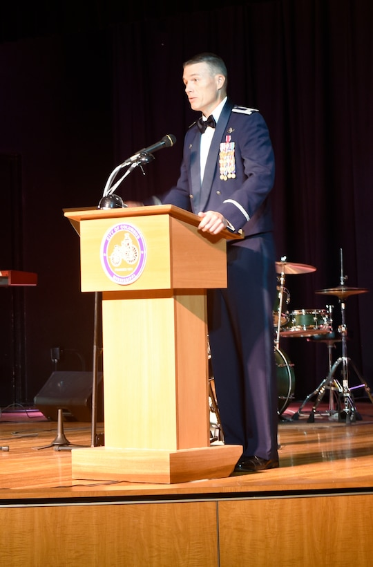 Col. Doug Gosney, 14th Flying Training Wing Commander, speaks Sept. 15, 2017, during the 14th FTW's 70th Air Force Birthday Ball at the Trotter Convention Center in Columbus, Mississippi. More than 400 Columbus Air Force Base members and community partners attended the event. (U.S. Air Force photo by Melissa Doublin)
