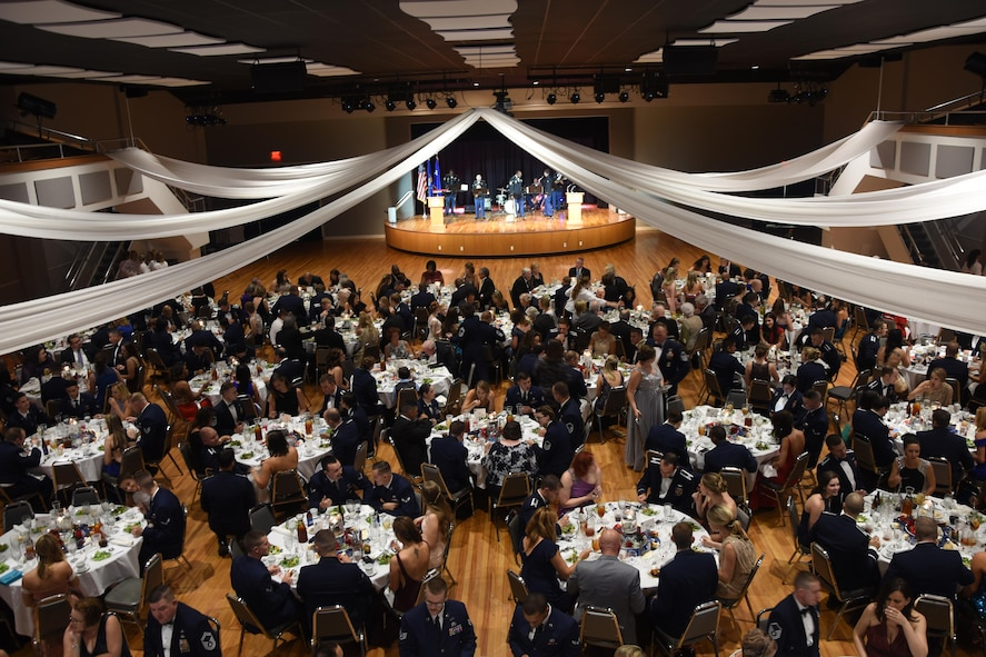 """More than 400 Columbus Air Force Base members and community partners gather at the Trotter Convention Center in Columbus, Mississippi, Sept. 15, 2017, to celebrate the Air Force's 70th birthday. The Trotter Convention Center lobby was lined with a historical display that featured some of the Air Force's and the base's key points in its existence and supported the ball's theme, """"Airpower Starts Here."""" The event also included a Prisoner of War and Missing in Action remembrance ceremony, formal toasts to leaders of the military services, a ceremonial cake cutting, and music performed live by the 41st Army Band. (U.S. Air Force photo by Melissa Doublin)"""