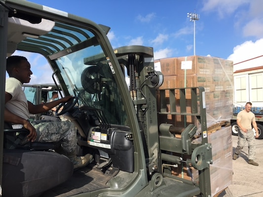 Airman 1st Class Dakwon Aktkinson, 502nd Logistics Readiness Squadron forklift operator, moves cargo around the air operations terminal Sept. 22, 2017 at Joint Base San Antonio-Kelly Field.  The cargo was being staged at the Federal Emergency Management Agency's Incident Support Base at Kelly for transport to areas devastated by Hurricane Maria (U.S. Air Force image/Dan Hawkins)