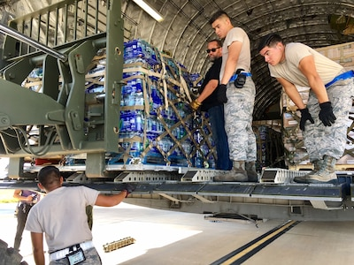 Airman from the 502nd Logistics Readiness Squadron load relief supplies aboard a C-17 Galaxy Sept. 22, 2017 at Joint Base San Antonio-Kelly Field.  The C-17, from the 21st Airlift Squadron at Travis Air Force Base, Calif., was bound for St. Croix, U.S.  Virgin Islands, to aid in Hurricane Maria relief efforts.  (U.S. Air Force image/Dan Hawkins)