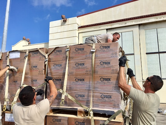 Airman from the 502nd Logistics Readiness Squadron and 26th Aerial Port Squadron finalize relief supply pallets for air transport Sept. 22, 2017 at Joint Base San Antonio-Kelly Field.  The supplies were being staged at the Federal Emergency Management Agency's Incident Support Base at Kelly for transport to areas devastated by Hurricane Maria (U.S. Air Force image/Dan Hawkins)